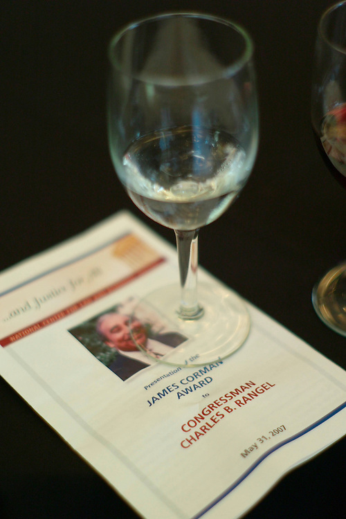 NEW YORK - May 31: A glass of white wine rests on program at the National Center for Law and Economic Justice, which was presenting House Ways and Means Chairman Charles B. Rangel, D-N.Y., with the James Corman Award, named for the late congressman and NCLEJ Board member. NCLEJ, founded in 1965, promotes economic justice, fairness and opportunity for the poor, works for reform in delivery of social services, and to safe-guard legal and constitutional rights for the poor. (Photo by Scott J. Ferrell/Congressional Quarterly).