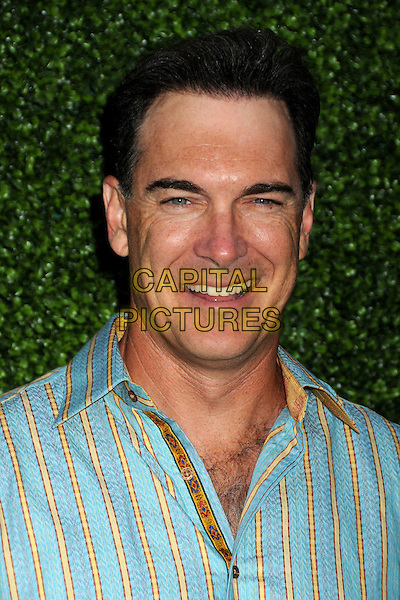 PATRICK WARBURTON.CBS Summer Press Tour Party 2010 held at The Tent, Beverly Hills, California, USA..July 28th, 2010.headshot portrait blue pink stripe .CAP/ADM/BP.©Byron Purvis/AdMedia/Capital Pictures.