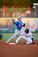 Oklahoma City Dodgers shortstop Drew Jackson (22) throws to first as Austin Dean slides into second base during a Pacific Coast League game against the New Orleans Baby Cakes on May 6, 2019 at Shrine on Airline in New Orleans, Louisiana.  New Orleans defeated Oklahoma City 4-0.  (Mike Janes/Four Seam Images)
