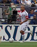 DC United defender Robbie Russell (3) dribbles down the wing. In a Major League Soccer (MLS) match, DC United defeated the New England Revolution, 2-1, at Gillette Stadium on April 14, 2012.