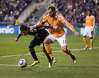 Roger Torres (8) of the Philadelphia Union fights for the ball with Brad Davis (11) of the Houston Dynamo during the game at PPL Park in Chester, PA.  Houston defeated Philadelphia, 2-1, to take home the one goal advantage in the home and home series..