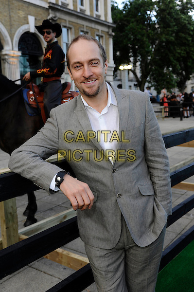 Derren Brown.The Channel 5 Launch Party for the new series of 'Dallas', Old Billingsgate Market, London, England..21st August 2012.half length suit hand in pocket leaning white shirt grey gray goatee facial hair .CAP/DH.©David Hitchens/Capital Pictures.