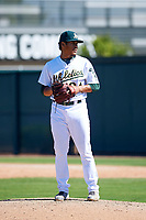 Oakland Athletics pitcher Jean Ruiz (64) prepares to deliver a pitch to the plate during an Instructional League game against the Cincinnati Reds on September 29, 2017 at Lew Wolff Training Complex in Mesa, Arizona. (Zachary Lucy/Four Seam Images)