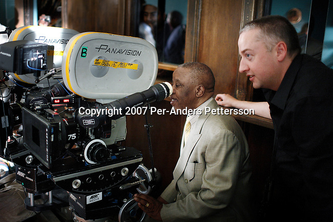 GABORONE, BOTSWANA - AUGUST 14: Seamus McGarvey, a cinema photographer, shows his camera to President Festus Mogae of Botswana during a tour on the set of The No 1 Ladies Detective Agency on August 14, 2007 in Gaborone, Botswana. The film is based on Alexander McCall Smith?s best-selling series. Anthony Minghella, the Oscar-winning director, and his crew filmed for months around Botswana and the Government of Botswana has invested $US5 Million in the project. (Photo by Per-Anders Pettersson/Getty Images)..