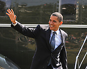 Washington, D.C. - March 6, 2009 -- United States President Barack Obama waves to friends as he arrives on the South Lawn of the White House in Washington, D.C. on Friday, March 6, 2009 after making remarks at the Columbus (Ohio) Police Graduation Exercise..Credit: Ron Sachs / Pool via CNP