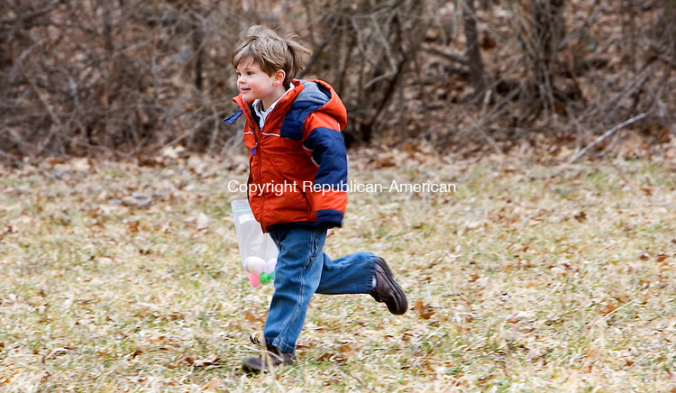 WOODBURY, CT- 16 MARCH 2008- 031608JT06-<br /> Bryan Kraus, 4, of Trumbull, runs across a field at Flanders Nature Center in Woodbury on Sunday during the Family Fun egg hunt.<br /> Josalee Thrift / Republican-American