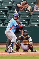 Tennessee Smokies catcher Kyle Schwarber (12) at bat in front of catcher Justin O'Conner and umpire Alex Ransom during a game against the Montgomery Biscuits on May 25, 2015 at Riverwalk Stadium in Montgomery, Alabama.  Tennessee defeated Montgomery 6-3 as the game was called after eight innings due to rain.  (Mike Janes/Four Seam Images)