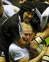 Tamara Taylor of England Women is tackled by Justine Lavea of the Black Ferns during the test match between England Women and the Black Ferns at Twickenham on Saturday 01 December 2012 (Photo by Rob Munro)