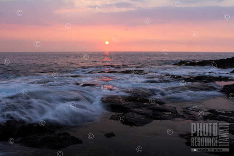 A long exposure image of incoming waves at sunset, Kona Coast, Big Island.