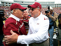 TALLAHASSEE, FL 11/21/09-FSU-MARY FB09 CH18-Florida State Head Coach Bobby Bowden, left, greets Defensive Coordinator Mickey Andrews during a ceremony to honor his service to FSU, Saturday at Doak Campbell Stadium in Tallahassee. .COLIN HACKLEY PHOTO