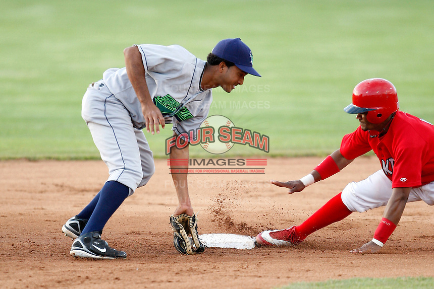 July 3, 2009:  Ernesto Manzanillo of the Jamestown Jammers gets the throw as Luis De La Cruz slides in during a game at Dwyer Stadium in Batavia, NY.  The Jammers are the NY-Penn League Short-Season Class-A affiliate of the Florida Marlins.  Photo by:  Mike Janes/Four Seam Images