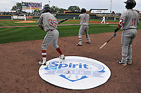 Jeremy Rivera (35) , Luis Alejandro Basabe (5) and Michael Chavis (11) of the Greenville Drive wait on deck before the first pitch on Thursday, April 14, 2016, opening day at the Columbia Fireflies' new Spirit Communications Park in Columbia, South Carolina. The Mets affiliate moved to Columbia this year from Savannah. Columbia won, 4-1. (Tom Priddy/Four Seam Images)
