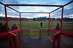Witton Albion 1 Warrington Town 2, 26/12/2017. Wincham Park, Northern Premier League. A segregation barrier frames the action at Wincham Park, home of Witton Albion (in red) during their Northern Premier League premier division fixture with Warrington Town. Formed in 1887, the home team have played at their current ground since 1989 having relocated from the Central Ground in Northwich. With both team chasing play-off spots, the visitors emerged with a 2-1 victory, the winner being scored by Tony Gray in second half injury time, watched by a crowd of 503. Photo by Colin McPherson.