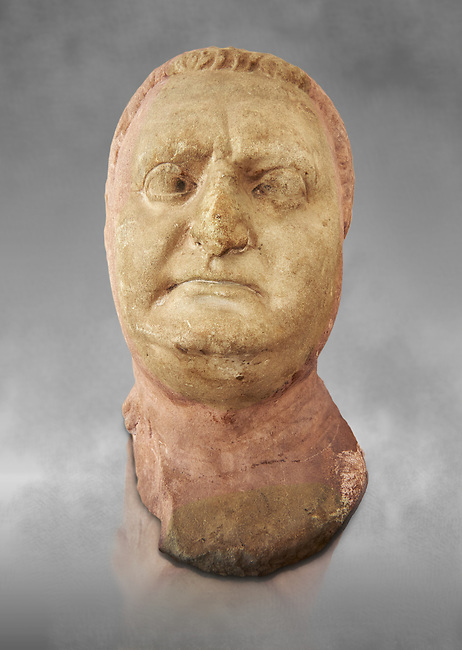 Roman sculpture of the Emperor Vitellius, excavated  from Althiburos sculpted circa 20 April 69-20 Dec 69AD. The Bardo National Museum, Tunis, Inv No: C.1784. Against a grey art background.