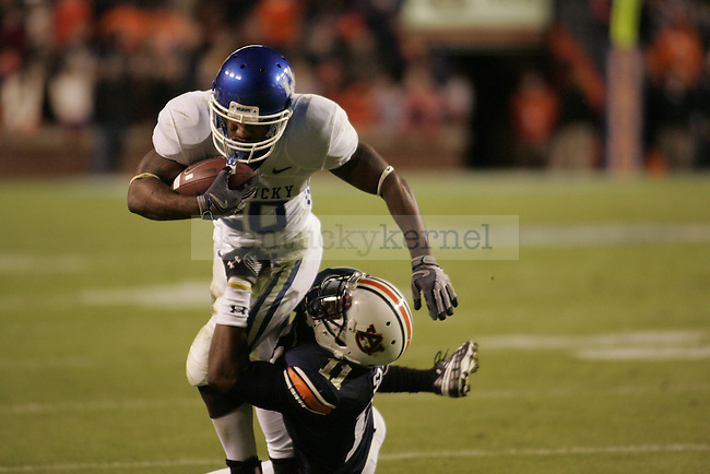 UK tailback Derrick Locke gets pushed out of bounds by Auburn defensive back Mike Slade in the first half of Saturday's game..Photo by Zach Brake | Staff
