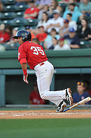 Shortstop Jeremy Rivera (35) of the Greenville Drive bats in a game against the Columbia Fireflies on Saturday, April 23, 2016, at Fluor Field at the West End in Greenville, South Carolina. Columbia won, 7-3. (Tom Priddy/Four Seam Images)