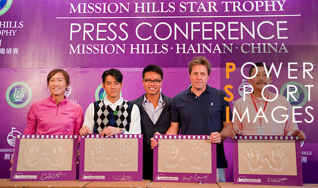 HAIKOU, CHINA - OCTOBER 28: (L-R) LPGA Tour player Candie Kung of Taiwan, Hong Kong singer Aaron Kwok, Dr. Ken Chu, Vice Chairman of Mission Hills Group, Hollywood actor Hugh Grant of Great Britain and Chinese film director He Ping pose with their handprints during a press conference as part of the Mission Hills Star Trophy on October 28, 2010 in Haikou, China. The Mission Hills Star Trophy is Asia's leading leisure liflestyle event and features Hollywood celebrities and international golf stars.  Photo by Victor Fraile / The Power of Sport Images