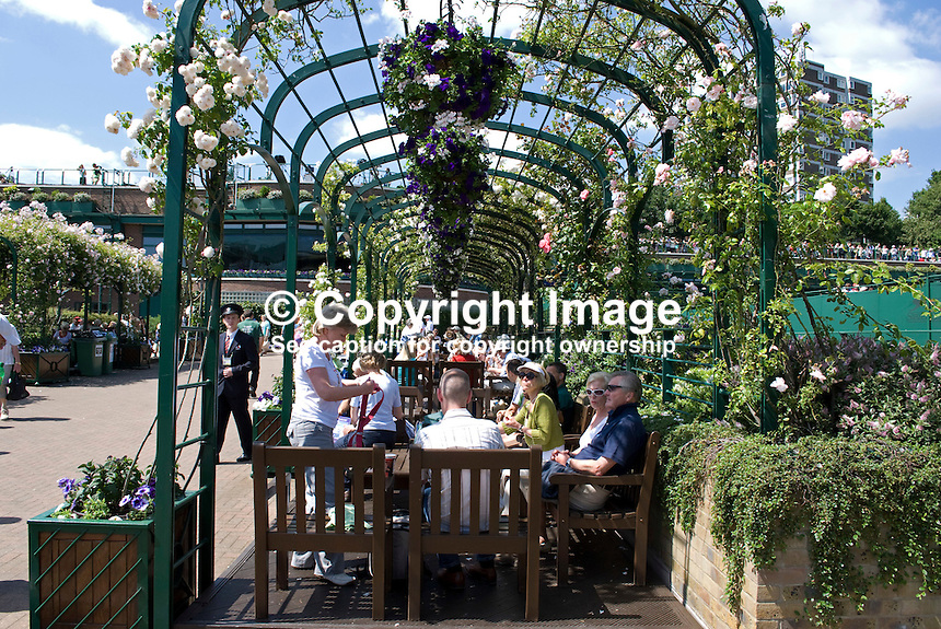 Visitors snacking, chatting, or just relaxing under a flower-laden pergula at the Wimbledon Tennis Championships. 200906232589..Copyright Image from Victor Patterson, 54 Dorchester Park, Belfast, UK, BT9 6RJ..Tel: +44 28 9066 1296.Mob: +44 7802 353836.Voicemail +44 20 8816 7153.Skype: victorpattersonbelfast.Email: victorpatterson@mac.com.Email: victorpatterson@ireland.com (back-up)..IMPORTANT: If you wish to use this image or any other of my images please go to www.victorpatterson.com and click on the Terms & Conditions. Then contact me by email or phone with the reference number(s) of the image(s) concerned.