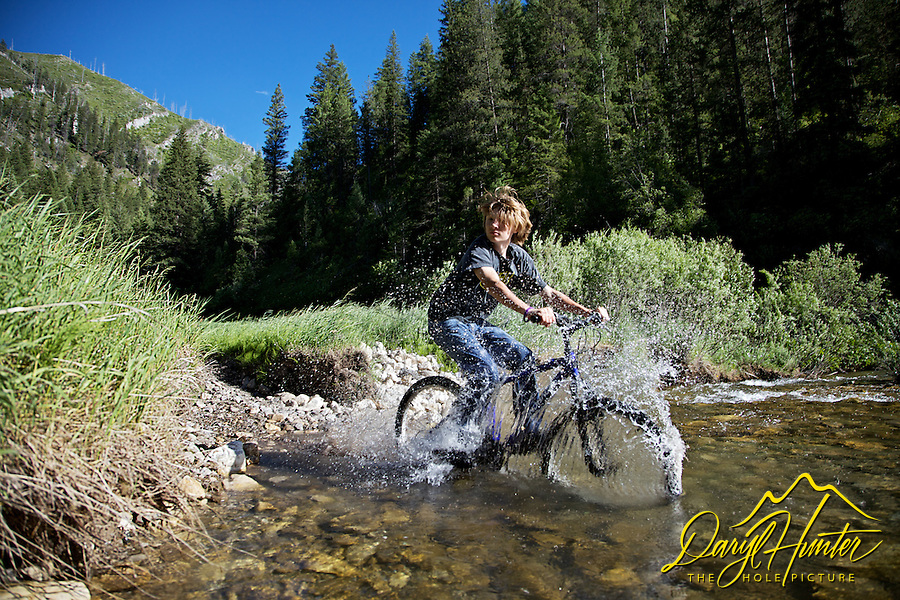 Scott Hunter Mountain Biking across Rainey Creek in Swan Valley, Idaho