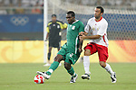 19 August 2008: Chibuzor Okonkwo (NGA) (2) plays the ball in front of Anthony Vanden Borre (BEL) (16).  The men's Olympic soccer team of Nigeria defeated the men's Olympic soccer team of Belgium 4-1 at Shanghai Stadium in Shanghai, China in a Semifinal match in the Men's Olympic Football competition.