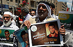 Palestinian supporters of the Islamic militant movement of Hamas, hold pictures of their relatives jailed at the Palestinian authority prisons as they protest close to president Mahmud Abbas' headquarters, in the West Bank city of Ramallah, on July 4 2012. The protesters are demanding the release of their jailed relatives. Photo by Issam Rimawi
