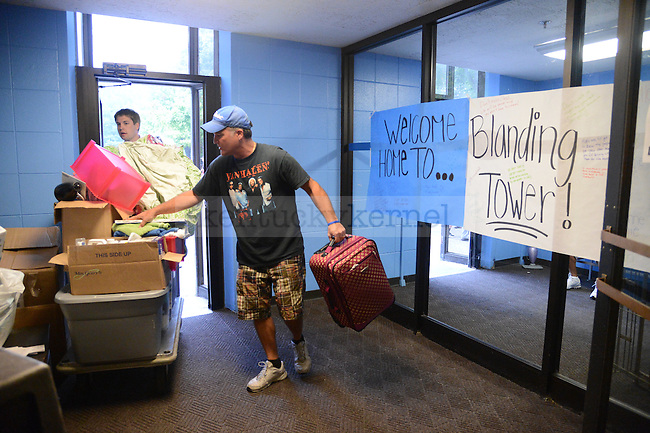 Parents help freshman move into the dorms on South Campus on August 17th, 2012. Photo by Mike Weaver | Staff