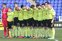 The St Mirren players during a minute silence before the Inverness Caledonian Thistle v St Mirren Scottish Professional Football League Premiership match played at the Tulloch Caledonian Stadium, Inverness on 29.3.14.