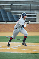 Blake Davey (27) of the UConn Huskies starts down the first base line against the Wake Forest Demon Deacons at Wake Forest Baseball Park on March 17, 2015 in Winston-Salem, North Carolina.  The Demon Deacons defeated the Huskies 6-2.  (Brian Westerholt/Four Seam Images)