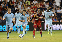 Luis Gil (21) Real Salt Lake chases the ball with Graham Zusi Sporting KC... Sporting Kansas City defeated Real Salt Lake 2-0 at LIVESTRONG Sporting Park, Kansas City, Kansas.
