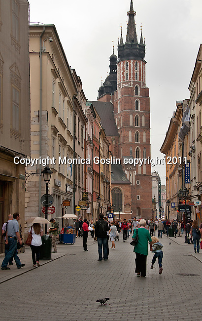 Looking down a street towards the Church of St. Mary's in Krakow, Poland