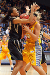 SIOUX FALLS, SD - MARCH 9: Sinclair Russell #35 from Oakland University ties up  Katie Lingle #42 from South Dakota State University in the first half of their game at the Sioux Falls Arena during the 2013 Summit League Tournament Saturday afternoon. (Photo by Dave Eggen/Inertia)
