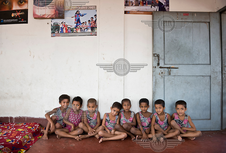 Children whose parents are too poor to send them to school sit at a shelter run by a local NGO that is supported by Dutch NGO Terre des Hommes.