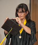 WNC student Sylvia Doioron adjusts her cap prior to commencement at the Western Nevada College in Fallon, Nev., on Tuesday, May 20, 2014. <br /> Photo by Kim Lamb