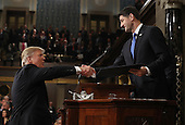 US President Donald J. Trump (L) shakes hands with Speaker of the House Paul Ryan (R) as he arrives to deliver his first address to a joint session of Congress from the floor of the House of Representatives in Washington, DC, USA, 28 February 2017.  Traditionally the first address to a joint session of Congress by a newly-elected president is not referred to as a State of the Union.<br /> Credit: Jim LoScalzo / Pool via CNP