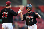 BOSTON, MA - APRIL 17: UMass' Eddy Hart (8) is congratulated by teammate Collin Shapiro after scoring against Harvard in the third inning during the 30th Annual Baseball Beanpot Championship Game at Fenway Park in Boston, Massachusetts on April 17, 2019. Photo by Christopher Evans