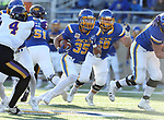 BROOKINGS, SD - DECEMBER 2: Isaac Wallace # 35 from South Dakota State breaks through the line against Northern Iowa during their FCS Division 1 playoff game Saturday afternoon at Dana J. Dykhouse Stadium in Brookings, SD. (Photo by Dave Eggen/Inertia)