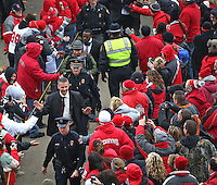 The Ohio State University head football coach Urban Meyer high fives a gauntlet of fans as he and the team head over to Ohio Stadium on November 1, 2014. (Chris Russell/Dispatch Photo)