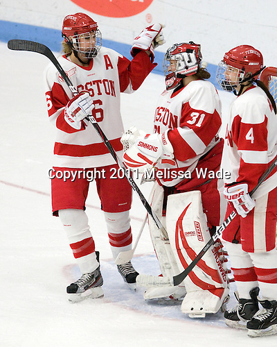 Carly Warren (BU - 6), Braly Hiller (BU - 31), Kathryn Miller (BU - 4) - The Boston University Terriers defeated the visiting University of Connecticut Huskies 4-2 on Saturday, November 19, 2011, at Walter Brown Arena in Boston, Massachusetts.