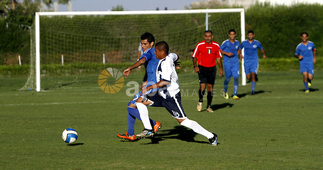 Palestinian soccer team al-Shatea services club compete against al-Helal club during the Premier League in Gaza City on Sept. 29, 2013. al-Shatea services club beat off al-Helal club 4-2. Photo by Alaa Shamaly