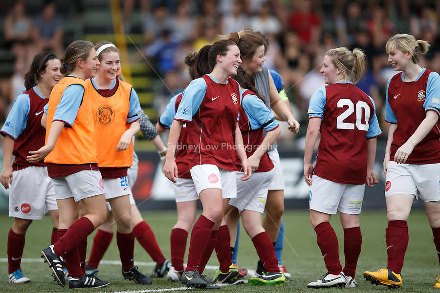 Sandringham players celebrate their win in the grand final of the 2013 Women's Premier League at the Veneto Club, Bulleen. Photo Sydney Low.