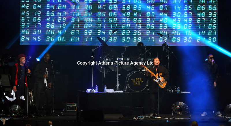Astro with Ali Campbell of UB40 plays the guitar on stage<br />UB40 concert at Parc Y Scarlets, Llanelli, Wales, UK. Saturday 10 June 2017
