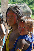 Pará State, Brazil. Aldeia Pukararankre (Kayapo). Women and child in the Warriors' house.