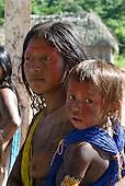 Pará State, Brazil. Aldeia Pukararankre (Kayapo). Women and child in the Warriors' house.