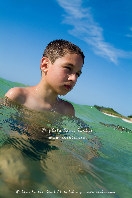Boy swimming in the tropical water at Cayo Jutias, Cuba.
