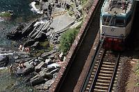 Un treno in transito lungo la costa delle Cinque Terre.<br /> A train makes his way along the coast of the Cinque Terre.<br /> UPDATE IMAGES PRESS/Riccardo De Luca