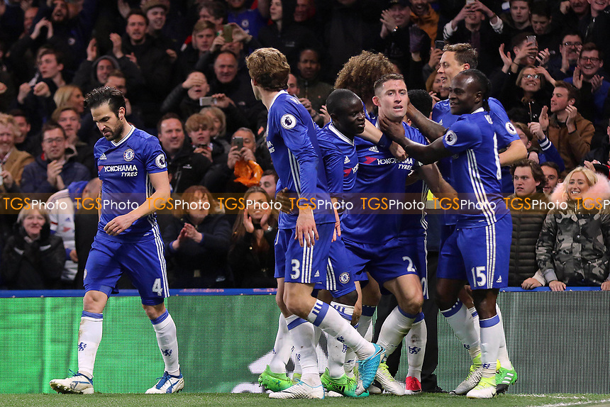 Chelsea players congratulate Gary Cahill after scoring their second goal during Chelsea vs Southampton, Premier League Football at Stamford Bridge on 25th April 2017