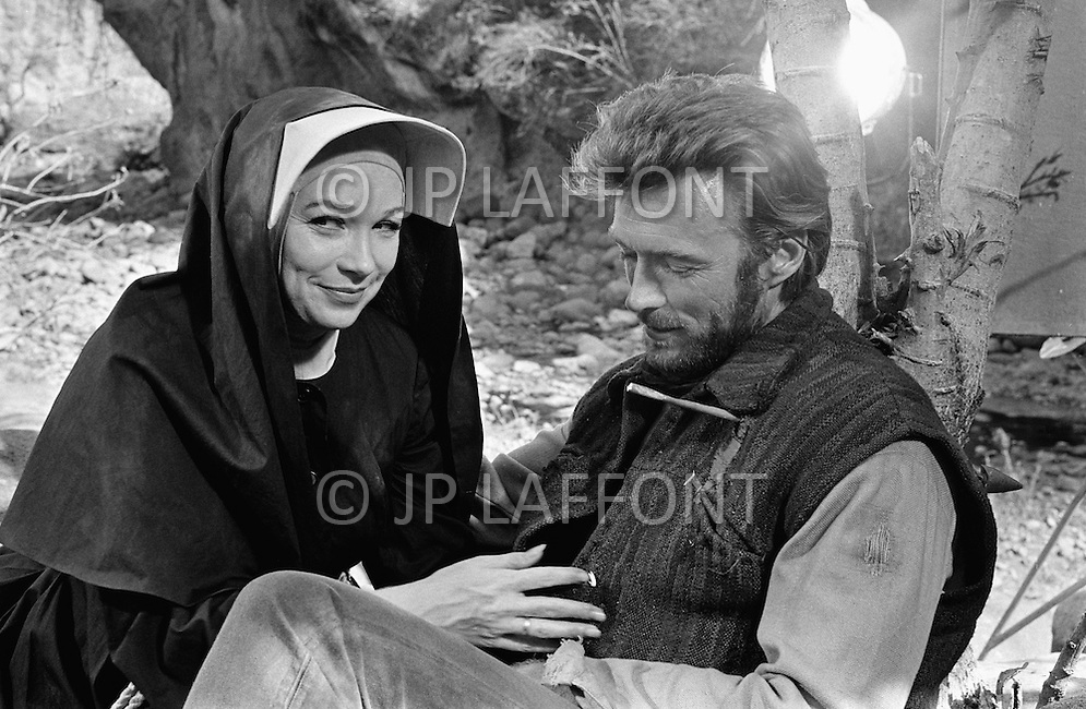 Mexico, 1969. Actress Shirley MacLaine and Actor Clint Eastwood on the movie set of the American 1970 western film Two Mules for Sister Sara directed by Don Siegel. Eastwood starred as the cowboy Hogan and Maclaine starred as Sister Sara in the comedy.