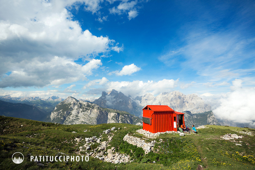 A couple outside the Bedin Bivouac Hut in the Italian Dolomites