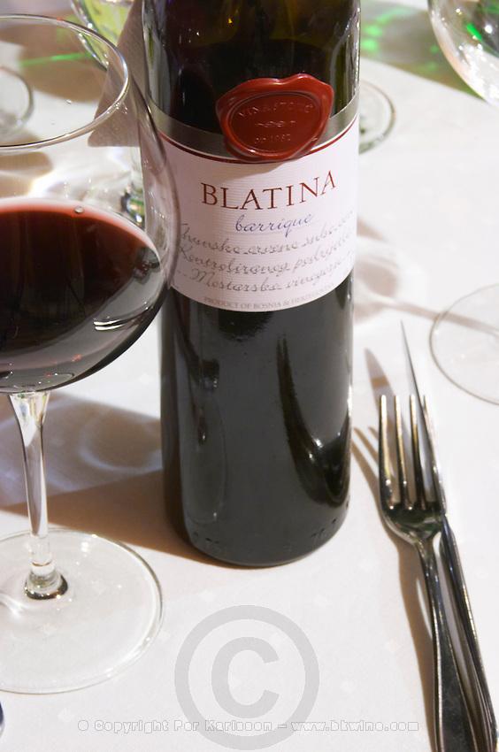 On the dining table, bottle of wine Blatina grape variety, barrique oak aged Vinastojic winery. Restaurant Restoran Rondo on the Rondo Square Historic town of Mostar. Federation Bosne i Hercegovine. Bosnia Herzegovina, Europe.