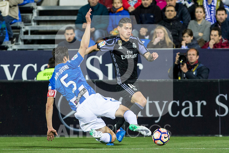 Martin Mantovani of Club Deportivo Leganes competes for the ball with James Rodriguezm- during the match of  La Liga between Club Deportivo Leganes and Real Madrid at Butarque Stadium  in Leganes, Spain. April 05, 2017. (ALTERPHOTOS / Rodrigo Jimenez) -